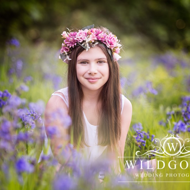Bluebell Photoshoot in Northamptonshire woodland with pretty girl in a pink flower crown