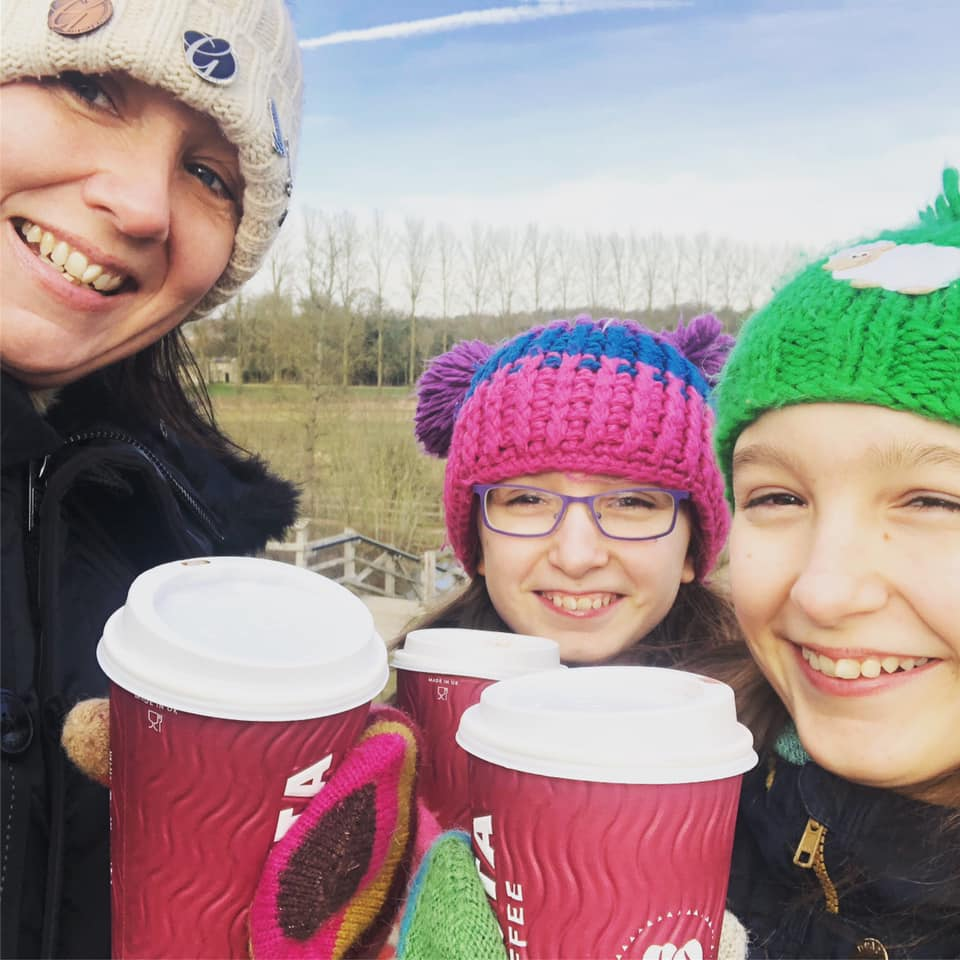 Mum and twins drinking a Costa coffee in winter