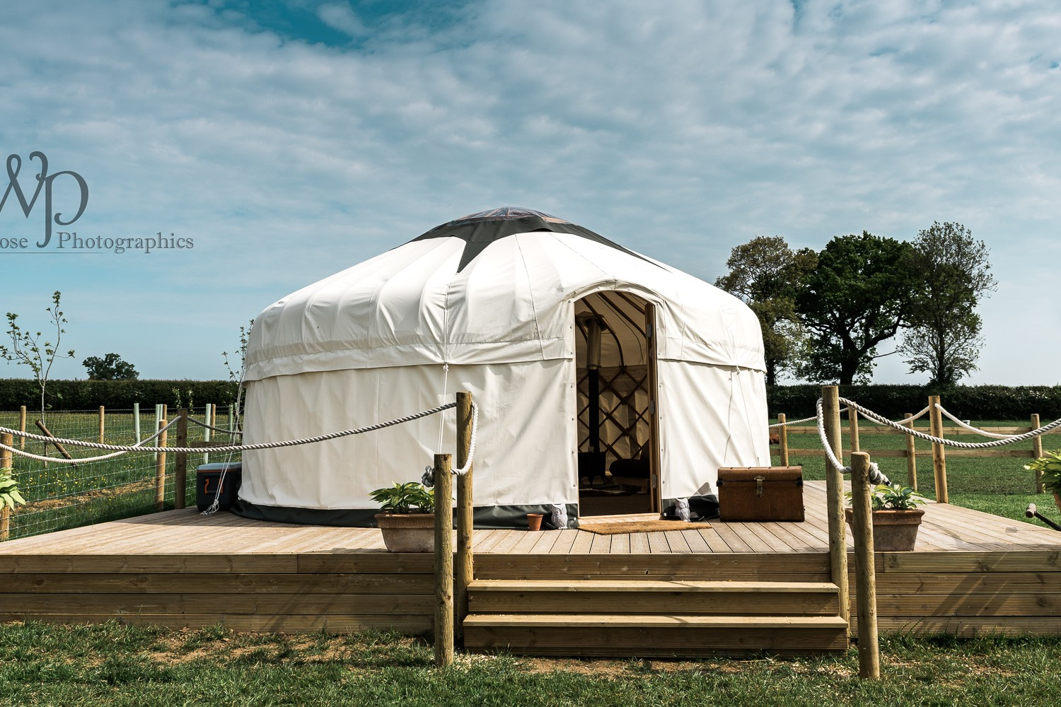 Brand photographer Glamping yurt outside with blue skies