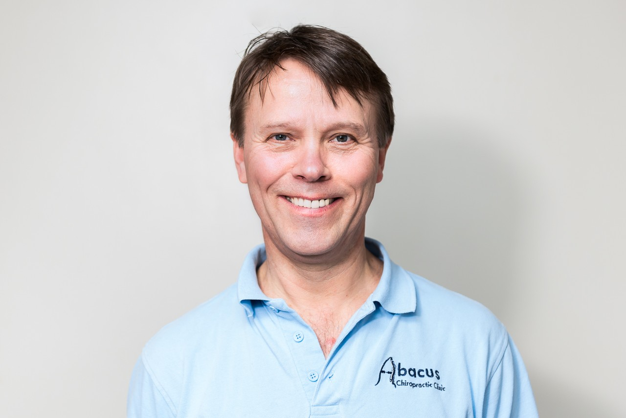 Brand photography head shot of man in a blue top