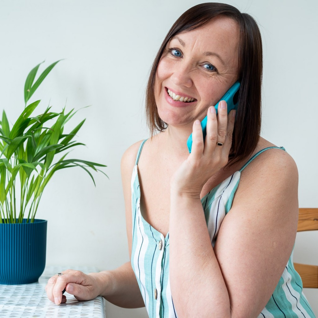 Brand photographer image with teal and white striped dress on an iPhone 12 pro